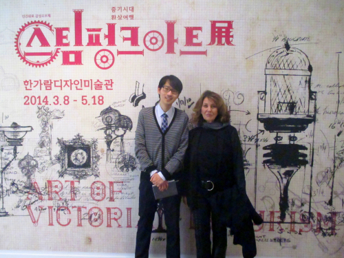 Frank and Leslie in front of sketch sign